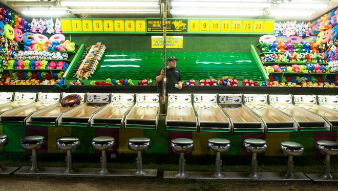 In this 2016 photo, games are setup on the midway at the Calhoun County Fairgrounds in Marshall. (Seth Graves/Enquirer file)