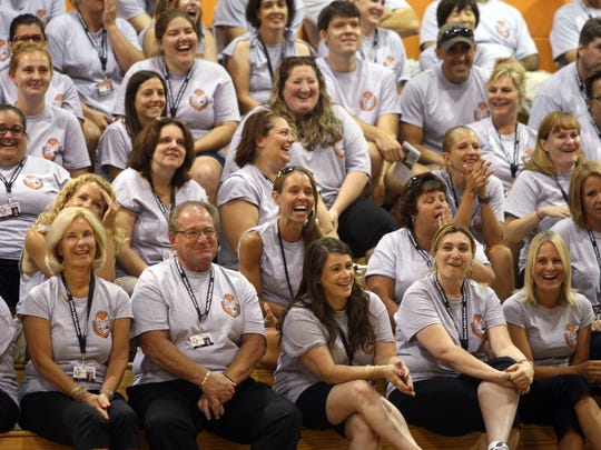 Linden teachers share a laugh during the district's opening ceremony for staff, Thursday, September 3, 2015, at Linden High School in Linden, NJ.