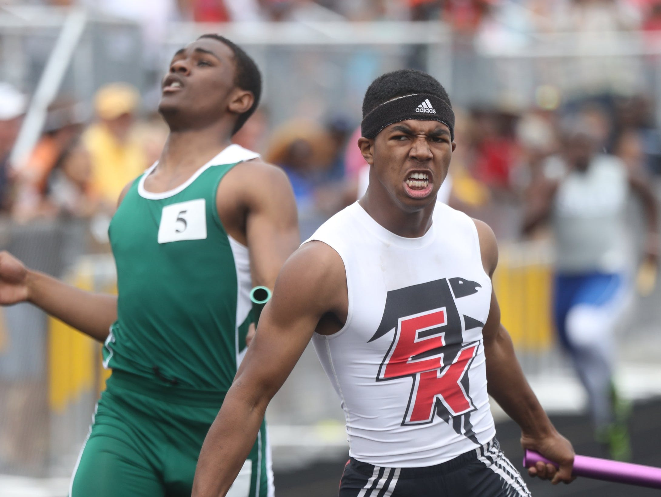 Shane Harris from East Kentwood high school finishes the 4x200 relay in front of Donovan Johnson from Cass Tech at the MHSAA Divison One State Track and Field championships on Saturday, June 4, 2016 at Hudsonville Eagles Stadium in Hudsonville MI. Kirthmon F. Dozier/Detroit Free Press