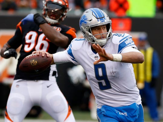 Detroit Lions quarterback Matthew Stafford (9) looks to pass against the Cincinnati Bengals during the first half at Paul Brown Stadium.