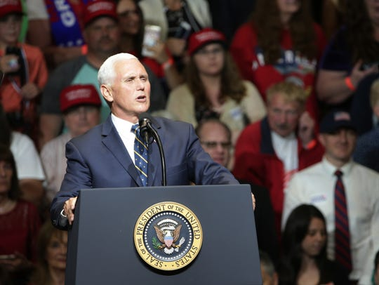 Former Gov. Mike Pence speaks in front of a supportive