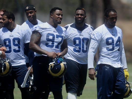 Aaron Donald (99), Eugene Sims (97), Michael Brockers (90) and Robert Quinn (94) have been a big part of a deep and dominant defensive line for the Rams this season.