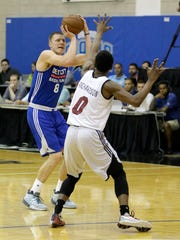 Henry Ellenson shoots over Miami's Josh Richardson during Thursday's summer league play in Orlando.