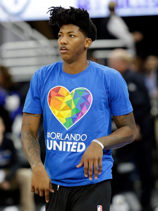 Orlando Magic's Elfrid Payton warms up wearing an Orlando United t-shirt during a tribute to the victims of the Pulse nightclub shooting prior to an NBA basketball game between the Orlando Magic and the Miami Heat, Wednesday, Oct. 26, 2016, in Orlando, Fla. (AP Photo/John Raoux)