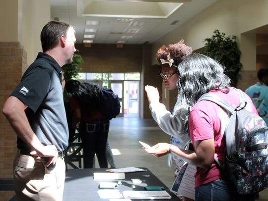 Pearl River Community College students talk to Kohler Engines recruiter Trey Smith about jobs at the company in Hattiesburg in this file photo.