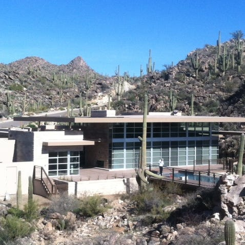This sustainable home in Stone Canyon in the Tucson area was built with high-end heating and air conditioning systems, high efficiency windows, and cabinets made from a species of wood that will regrow more quickly.