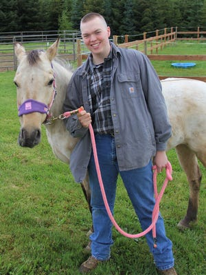 Garrett Kincaid of Lyons walks a horse at the Horses for Hope in Turner.