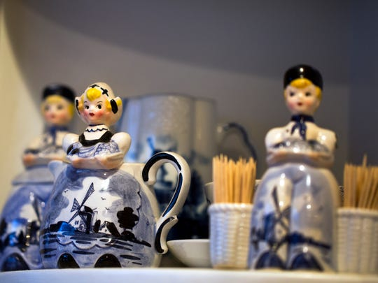 Cincinnati Pops conductor John Morris Russell and his wife Thea Tjepkema, live in a Tudor Revival home in Hyde Park. The large eat-in kitchen is newly remodeled. Tjepkema made sure the kitchen could display her Delft Blue pottery.