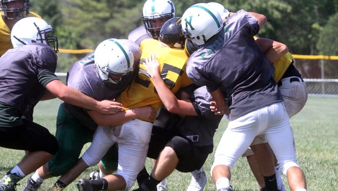 Yorktown defenders bring down a Nanuet running back during a multi-team football scrimmage at Brewster High School Aug. 27, 2016. Several area teams took part in the scrimmage in advance of next weekend's season opening games.