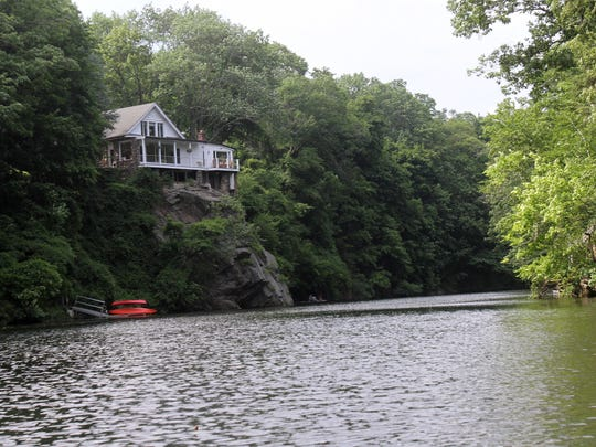 A house sits on a cliff overlooking the Croton River in Croton June 30, 2017.