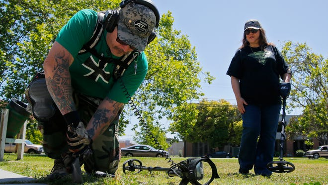 Robert Willsie of Salinas and Shirley Nakagawa of Soledad use their Garrett Metal Detectors at Central Park in Salinas.