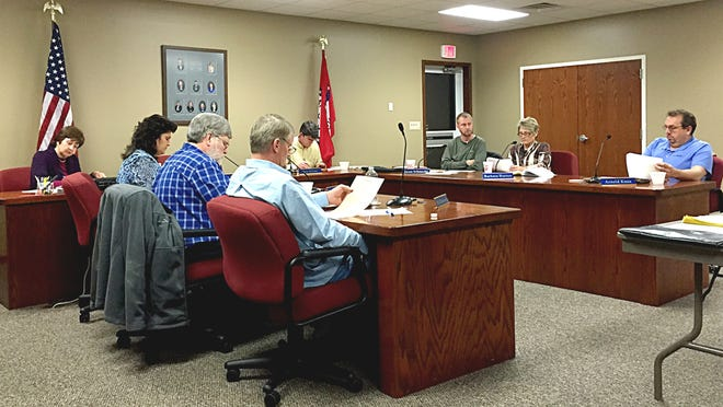 """Members of the Mountain Home School Board look over the results of a survey to create a profile for potential superintendent candidates. Their choice to top the list is someone who has a strong """"student-first"""" philosophy."""