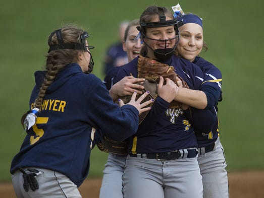 Eastern York's Emily Smith, center, gets a hug from