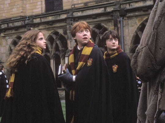 """Emma Watson, Rupert Grint and Daniel Radcliffe, from left, appear in a scene from Warner Bros.' """"Harry Potter and the Chamber of Secrets."""""""
