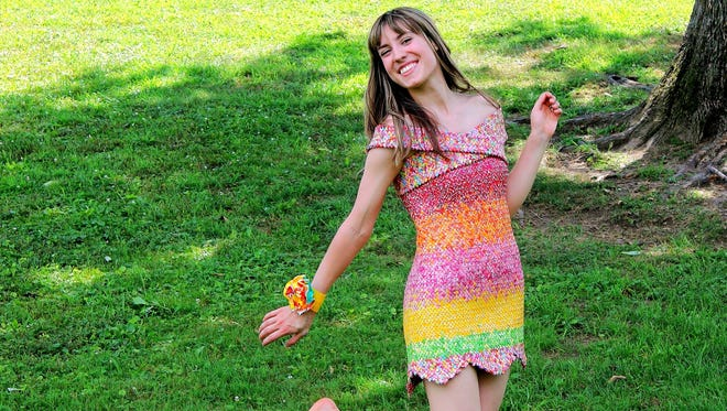 Emily Seilhamer, of Elizabethtown, is receiving national attention after a dress she made out of 10,000 Starburst wrappers went viral.