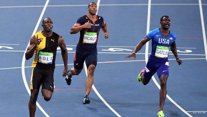 Usain Bolt (JAM) celebrates after defeating Justin Gatlin (USA) to win the men's 100.