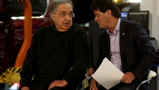 Sergio Marchionne, the chairman and CEO of Fiat Chrysler Automobiles (FCA) talks with Jerry Dias, the president of Unifor before their talk to employees at the FCA Windsor Assembly Plant in Windsor, Ontario Canada on Friday, May 6, 2016.