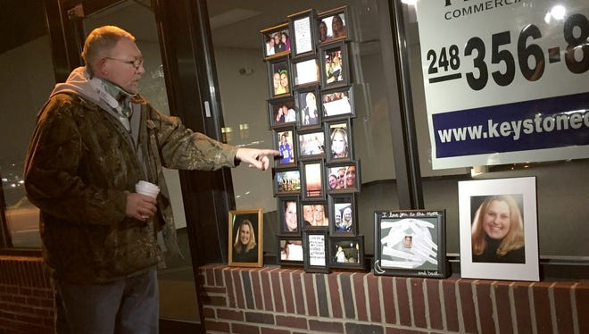 Jeff Kamin points to a photo of his stepdaughter, Chelsea Small. Small's family gathered Nov. 12, 2014 for a vigil at a former Advance America Cash Advance in Taylor, where she was shot and killed exactly one year ago.