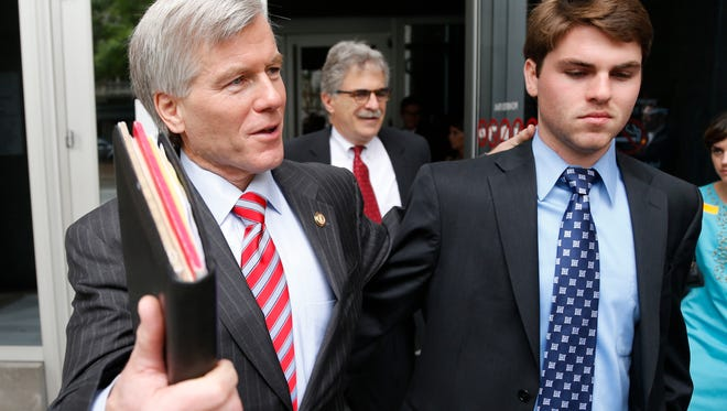 Former Virginia Gov. Bob McDonnell, left, leaves Federal Court with his son Bobby  as the jury begins its second day of deliberations in his corruption trial in Richmond, Va., Wednesday, Sept. 3, 2014.    (AP Photo/Steve Helber)