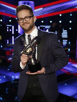 """Josh Kaufman, winner of """"The Voice,"""" is shown with his trophy."""