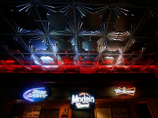 Metalic ceiling tiles above the bar are some of the