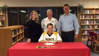 Nolan Lyons, middle, signs to Siena Heights lacrosse, where he will play with his older brother, Nick.