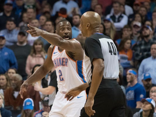 Oklahoma City Thunder guard Raymond Felton (2) argues with referee Leon Wood that Milwaukee Bucks forward Giannis Antetokounmpo (34) was out of bounds when he shot the winning goal during the second half of an NBA basketball game in Oklahoma City, Friday, Dec. 29, 2017. The Bucks defeated the Thunder 97-95. (AP Photo/J Pat Carter)