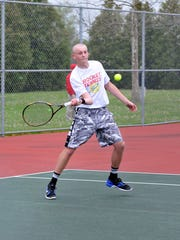 Oak Harbor junior Bo Hermes plays in a match Tuesday against visiting Port Clinton. The match will be finished at a later date because of rain.