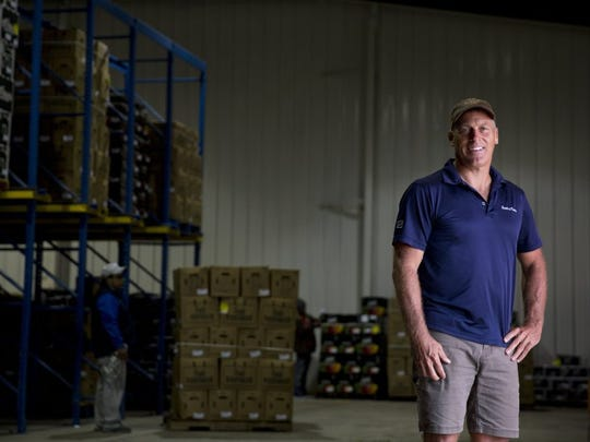 Alfie Oakes, the owner and founder of local agribusiness Oakes Farms, stands at one of his packing houses in Immokalee in 2016.
