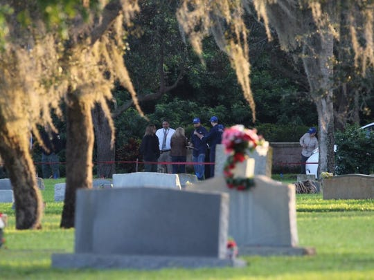 Martin County Sheriff's Office investigators and Florida Gulf Coast University forensic anthropologists prepare to exhume three graves at Fernhill Memorial Gardens on Jan. 11, 2016  in Stuart.