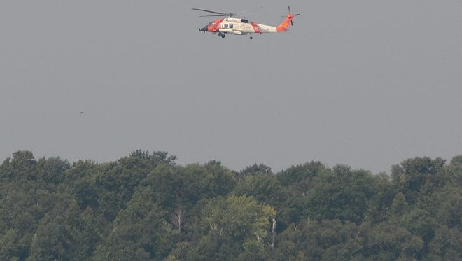 A U.S. Coast Guard helicopter conducting a search Sunday for a missing kayaker near Peninsula State Park.