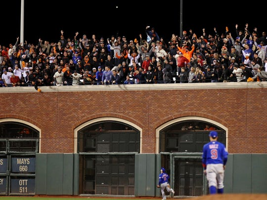 Cubs outfielder Albert Almora Jr. watches Joe Panik's