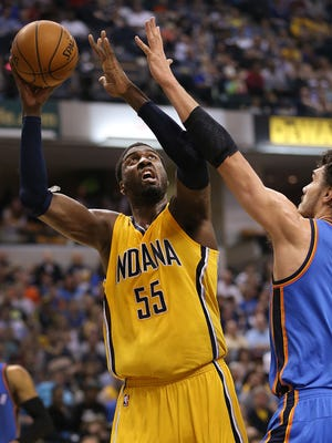 Indiana Pacers center Roy Hibbert (55) puts up a shot over Oklahoma City Thunder center Steven Adams (12) in the second half of their game Sunday, April 12, 2015 evening at Bankers Life Fieldhouse. The Pacers defeated the Thunder 116-104.
