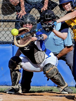 Highlands catcher Josie Daley receives the pitch Friday against Notre Dame Academy. The Bluebirds won, 4-0.