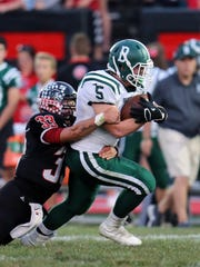 Bishop Brossart running back Nathan Bezold runs for a first down as Justin Blackburn makes the tackle in the game between the Ludlow Panthers and the Bishop Brossart Mustangs at Ludlow High School Sept 29, 2017.