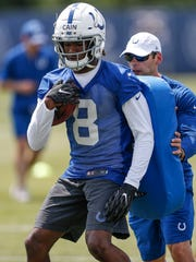 Indianapolis Colts rookie wide receiver Deon Cain (8) spins during a drill during rookie camp at the Colts Complex in Indianapolis, on Friday, May 11, 2018.