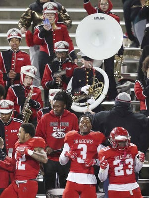 East High School football players dance with the school's marching band as they celebrate their 14-0 victory over Buchtel winning the City Series Championship at InfoCision Stadium at the University of Akron Friday, Nov. 1, 2019 in Akron. The school board again has voted to sideline all sports and activities for the first nine weeks of the 2020-21 school year because of the coronavirus pandemic.