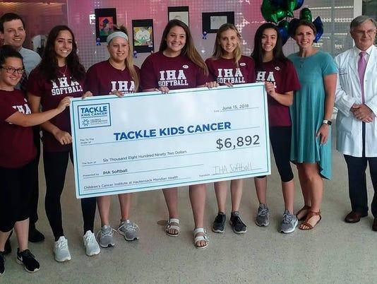 IHA softball charity fundraising