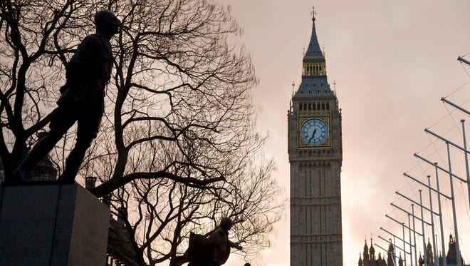 The sun rises behind The Elizabeth Tower, also known as Big Ben in London.