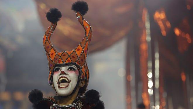 A performer from the Salgueiro samba school parades during Carnival celebrations at the Sambadrome in Rio de Janeiro, Brazil, Monday, Feb. 27, 2017.