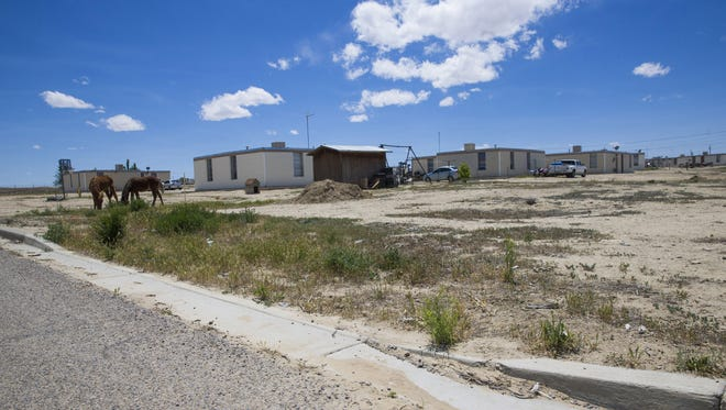 Sen. John McCain's report calls for a new board of directors at the Navajo Housing Authority, possible cutbacks in Navajo housing funds by Congress, and the creation of a separate agency to handle new-home development for the tribe.