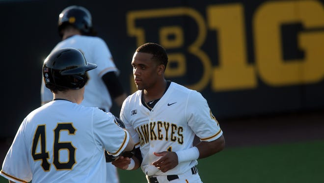 Iowa's Lorenzo Elion is welcomed at the dugout after a run during the Hawkeyes' game against Cornell College at Duane Banks Field on Tuesday, Feb. 27, 2018.