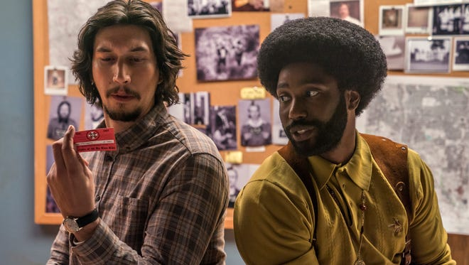 "Colorado Springs cops Flip (Adam Driver, left) and Ron (John David Washington) work together to infiltrate the 1970s-era KKK in ""BlacKkKlansman."""