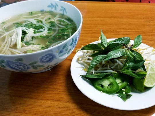 Pho is served in a very large bowl accompanied by a side plate of bean sprouts, jalapenos, fresh basil, and lime wedges, all of which can be added to the soup.