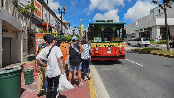 Tourists line up to catch a Red Guahan Shuttle Bus in Tumon on Feb. 24, 2018.