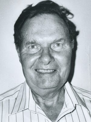 """This file photo from 1989 shows University of Iowa professor emeritus Robert """"Bob"""" Hogg, who died Tuesday at age 90."""