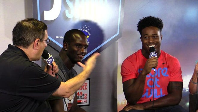 Titans players Jason McCourty and Avery Williams talk to George Plaster (left) during the J-Mac Show. Monday, Oct. 12.