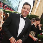 Jimmy Fallon arrives at the 67th Primetime Emmy Awards on Sunday, Sept. 20, 2015, at the Microsoft Theater in Los Angeles. (Photo by Rich Fury/Invision for the Television Academy/AP Images)