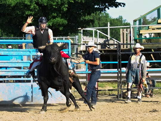 Andrew Benkovsky rides a bull during an amateur bull
