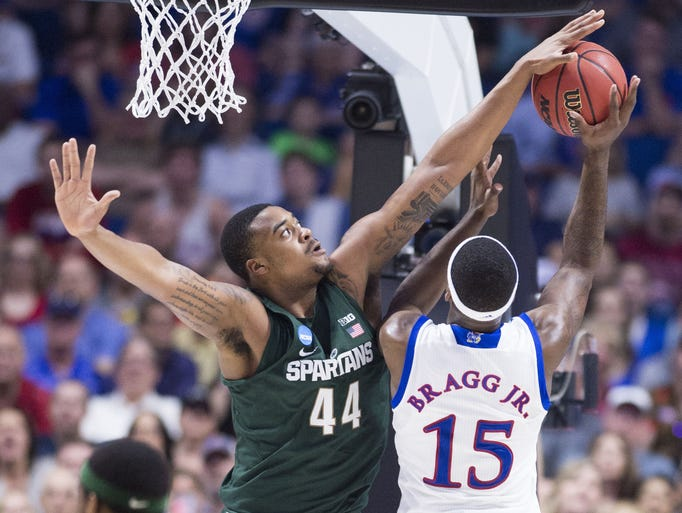 Michigan State forward Nick Ward (44) swats the ball